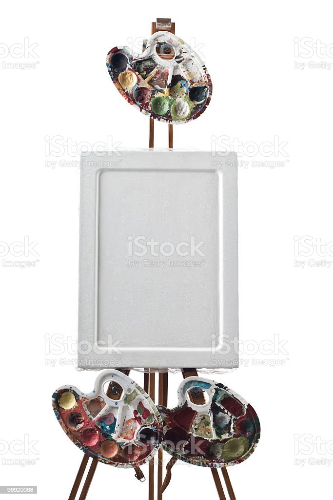 Empty canvas on a easel with pallets around royalty-free stock photo
