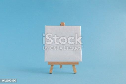 671393252istockphoto Empty canvas on easel 942992430