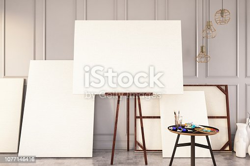 istock Empty Canvas with Painting Equipments 1077146416