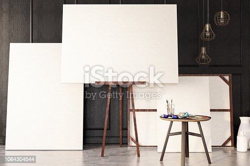 671393252istockphoto Empty Canvas with Painting Tools 1064304544