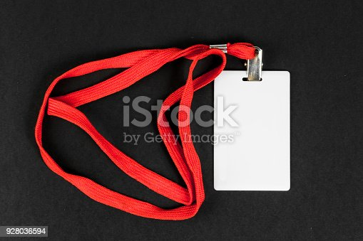 istock Empty card ID, icon with an orange belt on a black background. Space for text 928036594