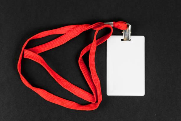leere karten-id, symbol mit einem orange gürtel auf einem schwarzen hintergrund. platz für text - übergeben stock-fotos und bilder