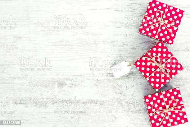 Empty card tied over red dotted gift box copy space picture id686843296?b=1&k=6&m=686843296&s=612x612&h=3eruci8pcfragpw3kljg1eek m1jxkex0utz0pw0ofw=