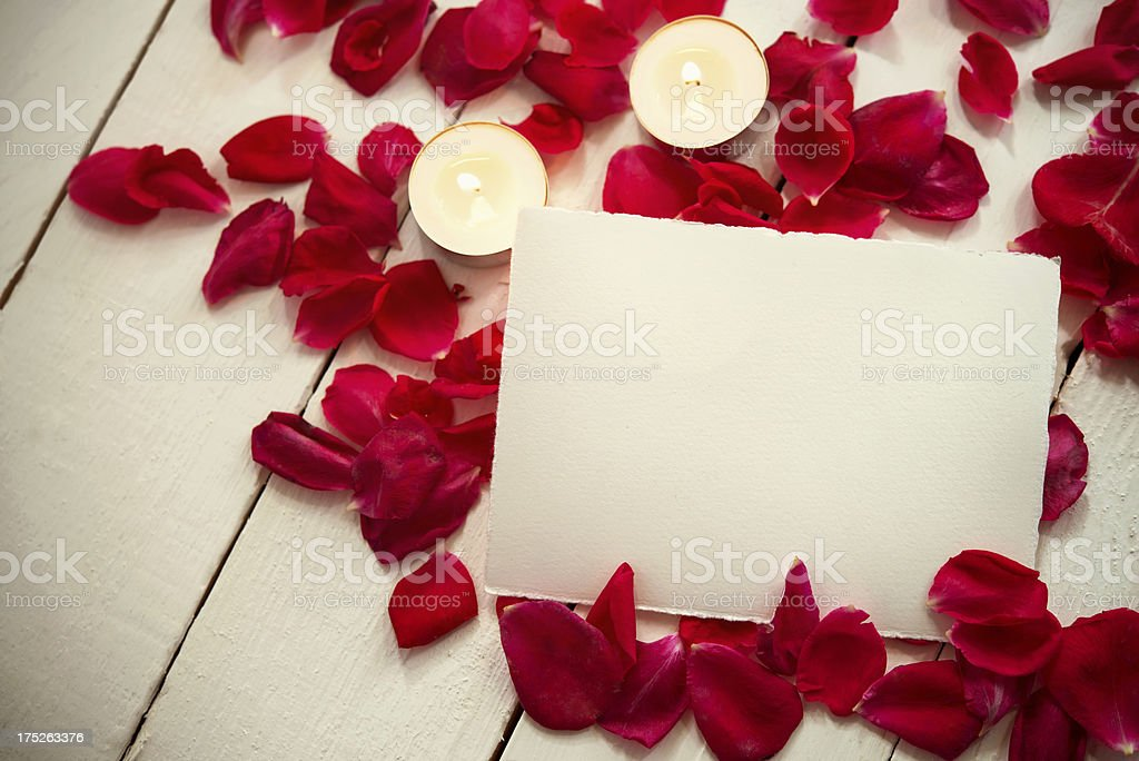 Empty card with rose petals and candle decoration royalty-free stock photo