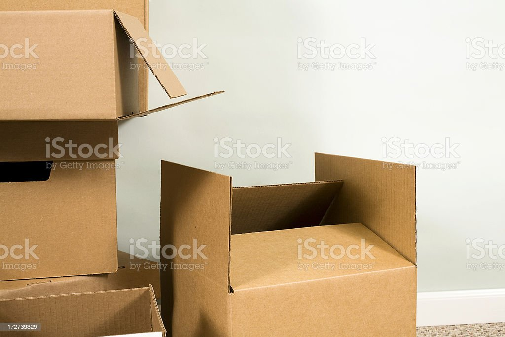 Empty cardboard moving boxes. Packing, unpacking. No people. Home. royalty-free stock photo