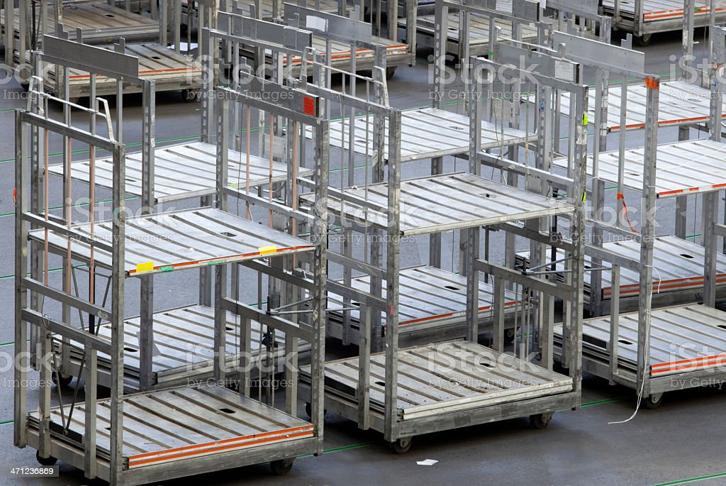 empty cargo carts at a distribution warehouse royalty-free stock photo