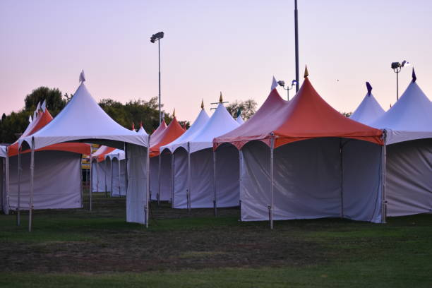 empty carnival orange and white tents - steven harrie stock photos and pictures