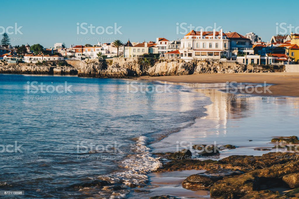 Empty Cascais, Portugal beach in the morning with no tourists on the beach stock photo