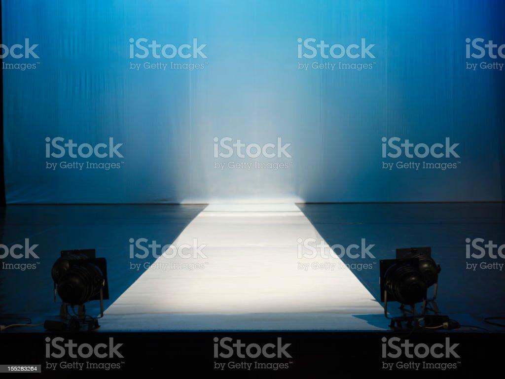 Empty catewalk stage lights stock photo