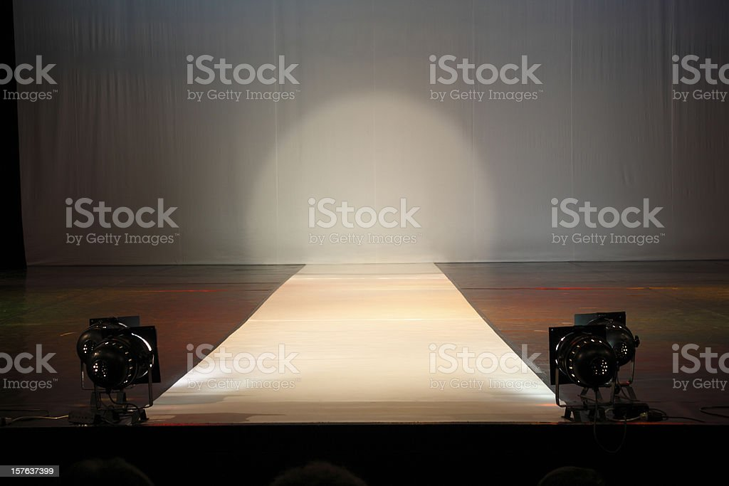 Empty catewalk stage lights stock photo