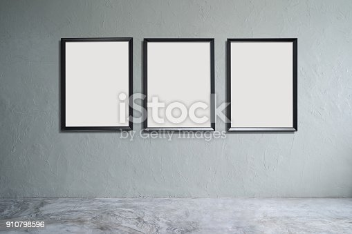 Empty Cement Floor And Concrete Wall With Three Empty Picture Frames ...