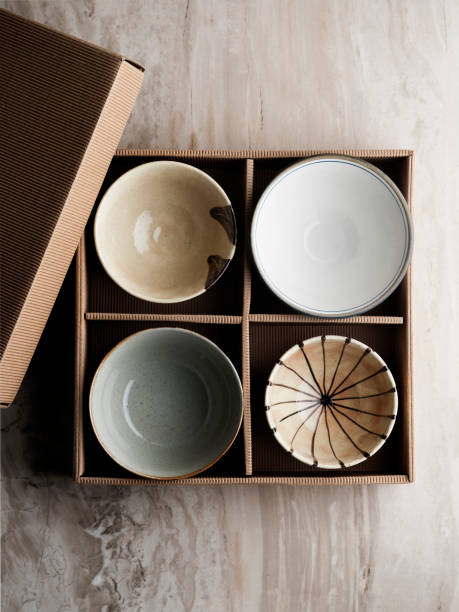 Empty Ceramic Bowl,Stack of plates and bowls in cardboard box,Bowl of china in cardboard box,Empty Ceramic Plate, stock photo