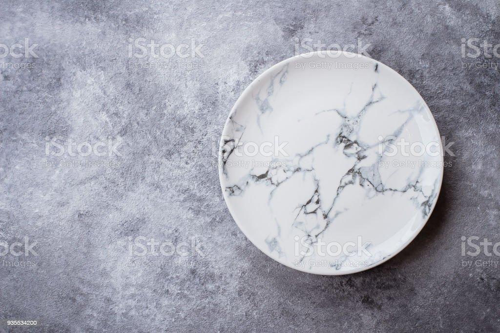 Empty ceramic marble plate on gray stone concrete table background. Copy space. Menu Recipe Concept stock photo
