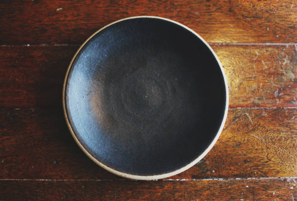 Empty Ceramic Plate on rustic wooden table stock photo