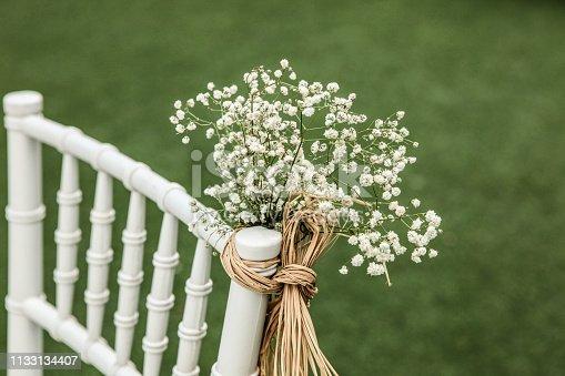 Empty chair at wedding ceremony