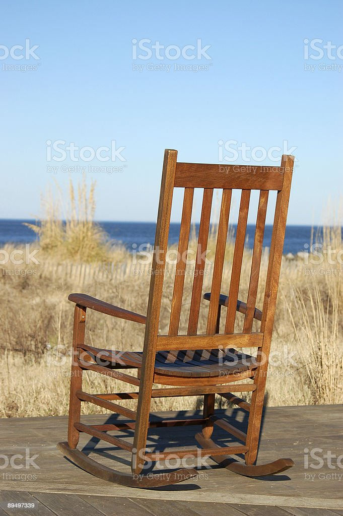Empty chair by the sea royalty free stockfoto