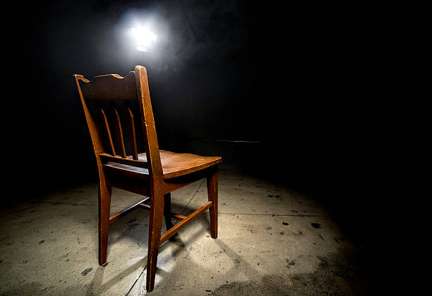 Empty Chair in an Interrogation Room stock photo