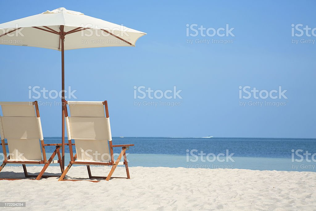 empty chairs and umbrella at a beach in Florida, USA stock photo