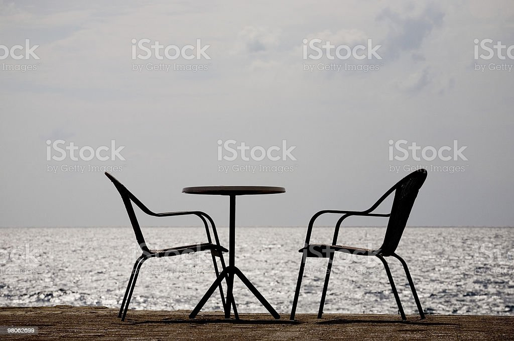 Empty chairs by the sea royalty-free stock photo