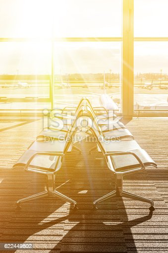 469824732istockphoto Empty chairs in the departure hall at airport. 622449802