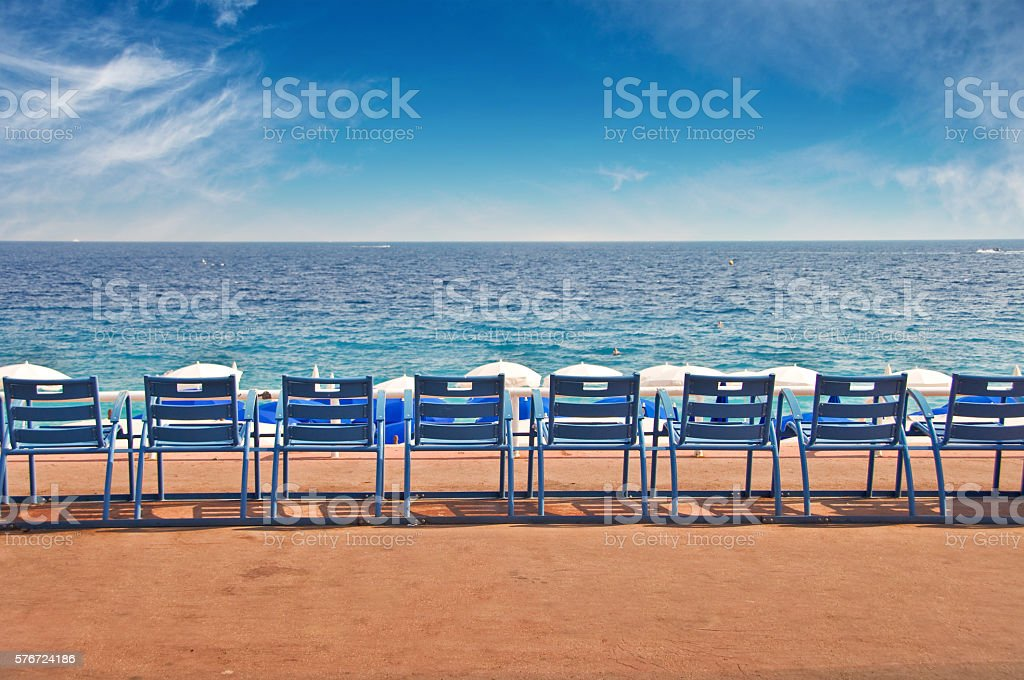 Empty chairs on the English Promenade in Nice, France stock photo