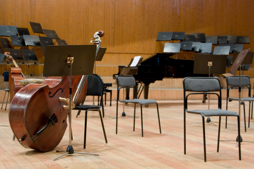 Empty chairs with orchestral instruments lay down