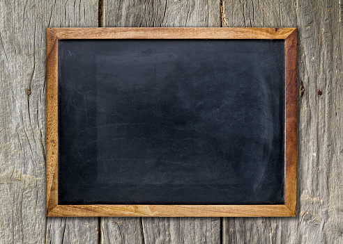 istock Empty chalkboard on wooden surface 498806418