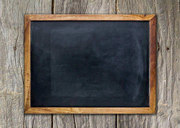 empty chalkboard on wooden surface - construction frame stock photos and pictures