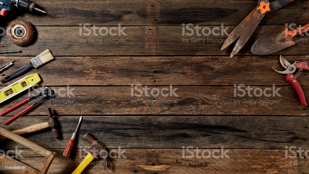 Empty chalkboard with many handy tools, on wooden background top view...