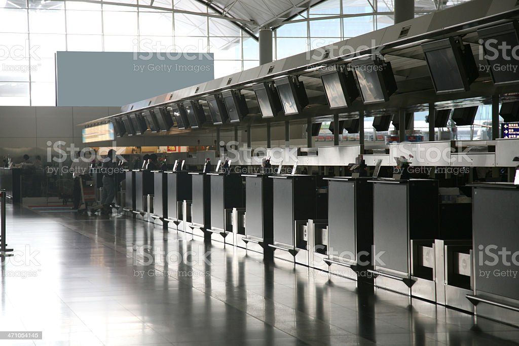 Empty Check-In Counters In Airport royalty-free stock photo