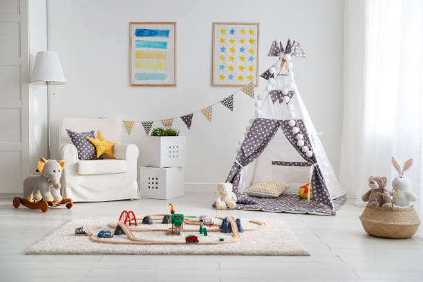 empty children's playroom with  tent and  toy railway stock photo