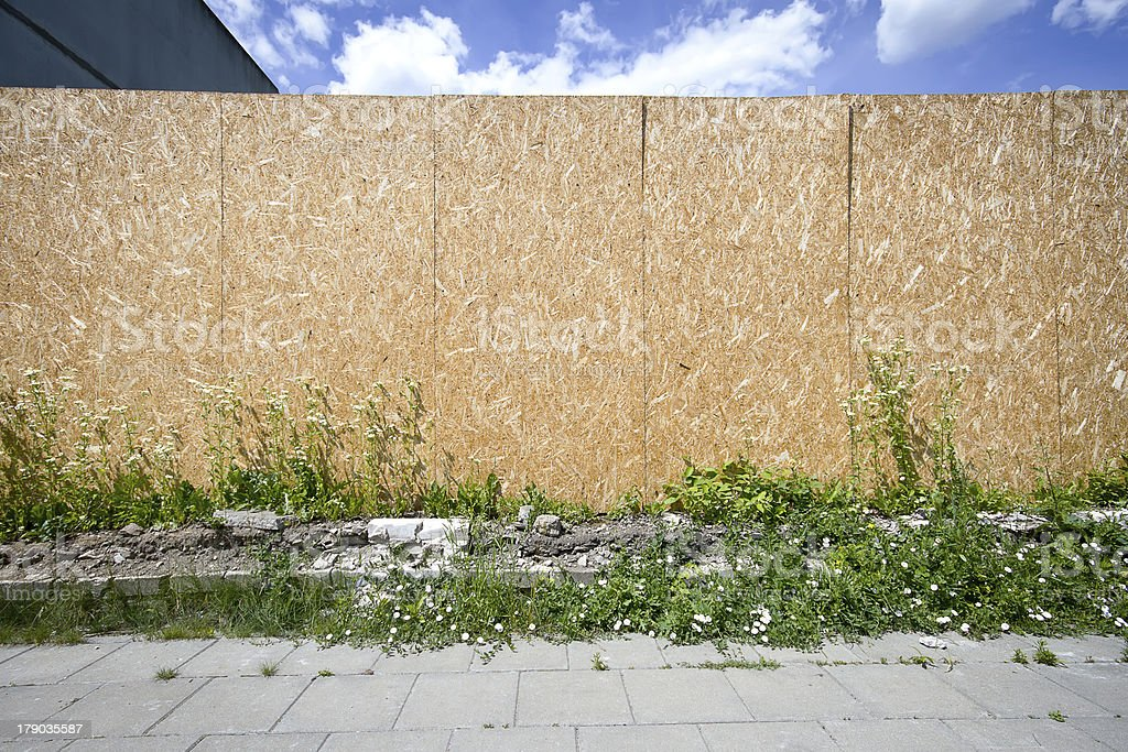 Empty chipboard fence stock photo