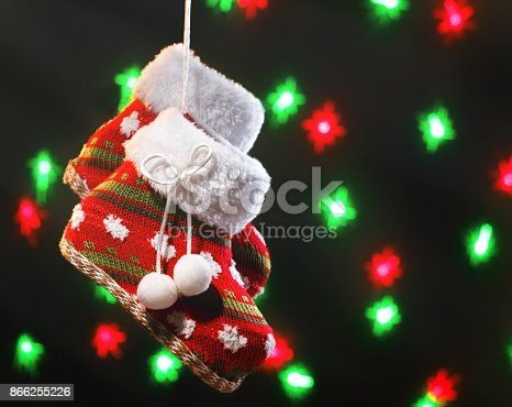 858960516 istock photo Empty christmas boots on dark background with blurred lights 866255226