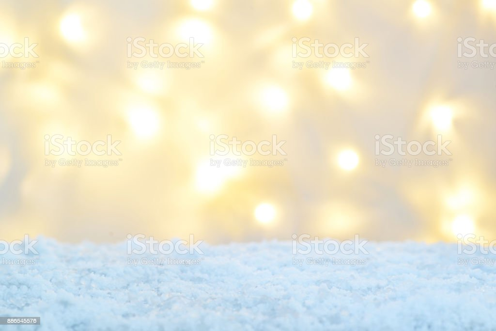 empty christmas lights background with snow stock photo