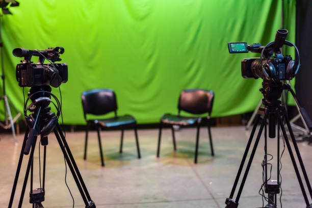 empty chroma studio with two mounted cameras waiting for action - green screen background stock photos and pictures