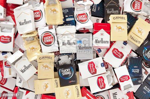 Buenos Aires, Argentina - October 31, 2012. Lots of empty cigarette packs of different brands. All of them where found thrown in the street showing how much these are consumed in the city