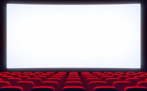 Empty cinema and white screen stock photo