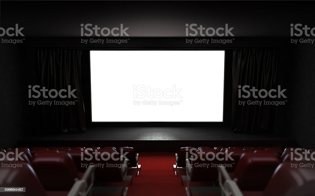 empty cinema auditorium with blank screen frame stock photo