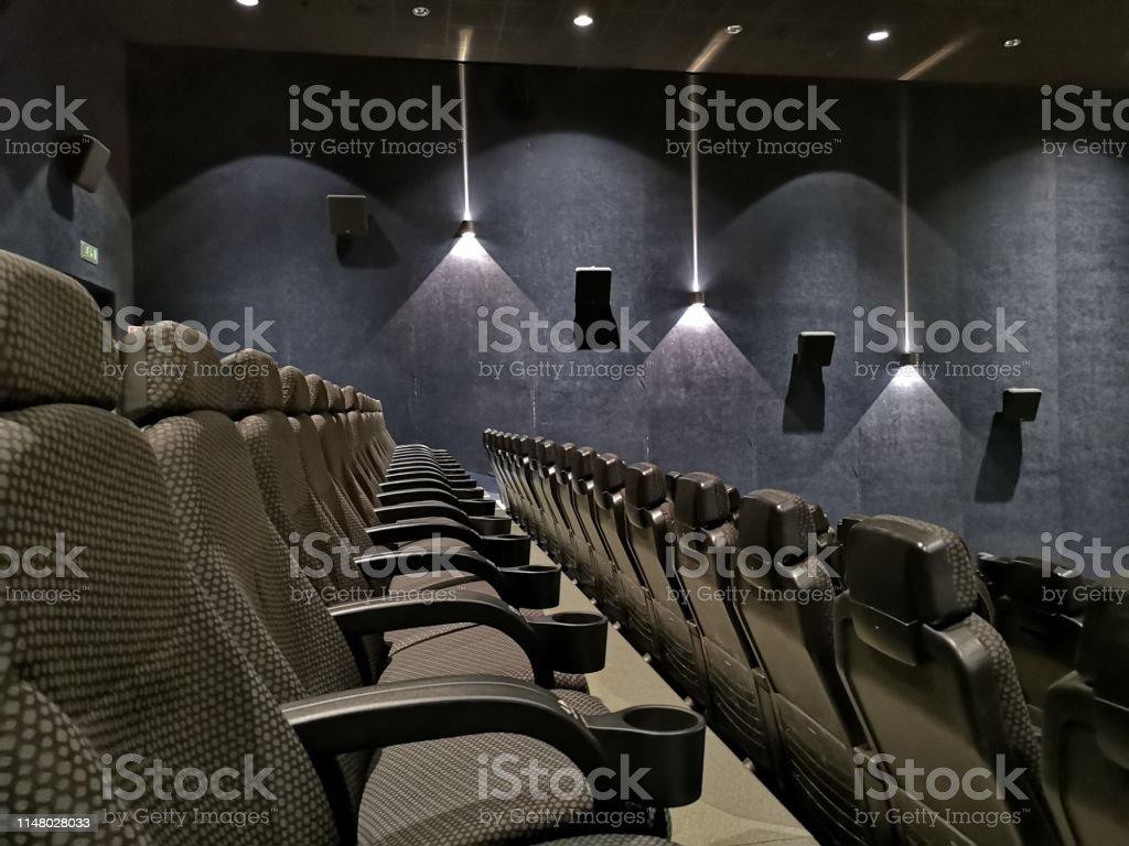 empty cinema auditorium with red seats