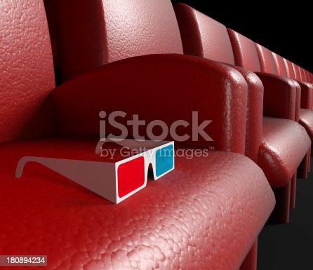 istock Empty cinema hall and 3d glasses 180894234
