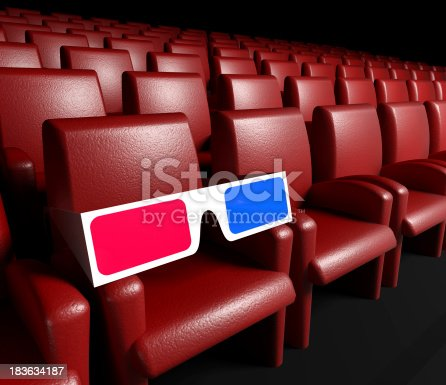 istock Empty cinema hall and 3d glasses 183634187