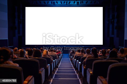 Empty cinema screen with audience. Ready for adding your picture. Screen has crisp borders. This shot was made using tripod with long exposure.