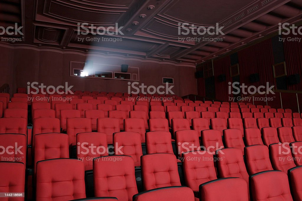 Empty cinema with red seats and detailed ceiling stock photo