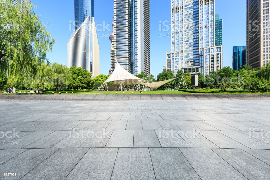 Empty city square road and modern commercial buildings scenery in Shanghai stock photo