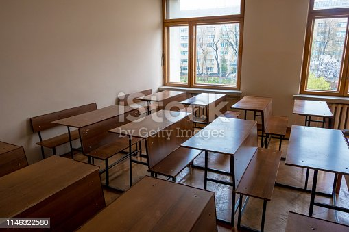 881192038 istock photo Empty classes with school students tables after studying year is over 1146322580