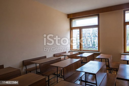 istock Empty classes with school students tables after studying year is over 1146322584