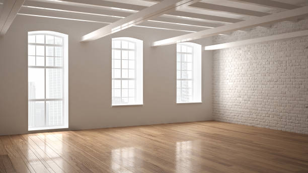Empty classic industrial space, open room with wooden floor and big windows, modern interior design stock photo