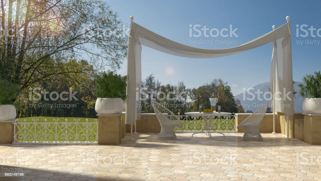 Empty classic terrace with canopy relax area, armchairs and table for breakfast, panoramic garden meadow 免版稅 stock photo
