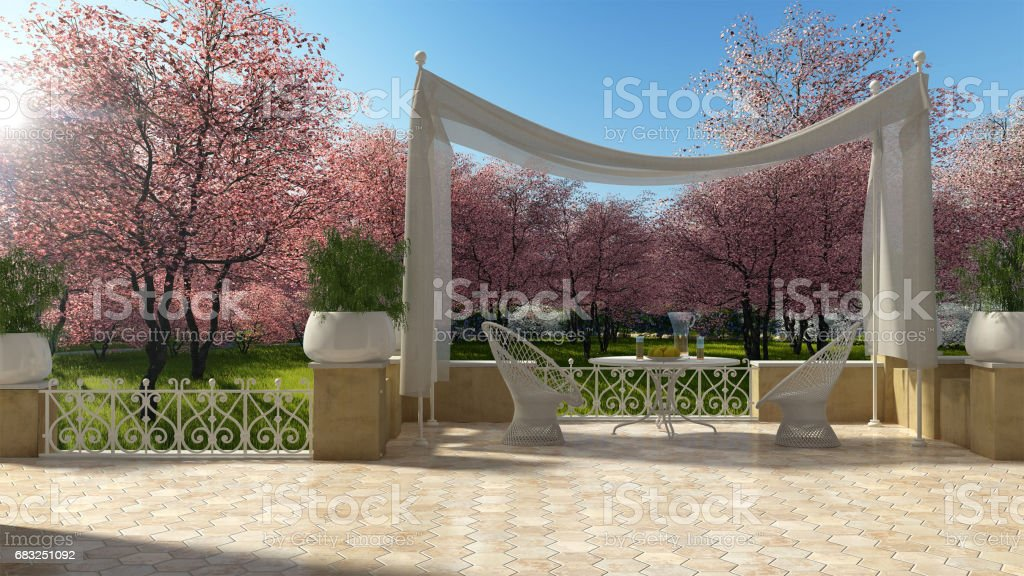 Empty classic terrace with canopy relax area, armchairs and table for breakfast, panoramic spring garden, pink flowering trees 免版稅 stock photo