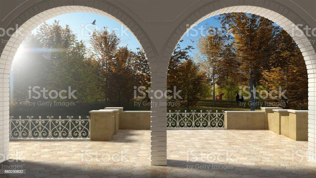 위조 된 철 방책 및 사암 아치 빈 클래식 테라스, 탁 트인가 정원과 방목 목마 royalty-free 스톡 사진